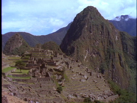 The ruins of Machu Picchu nestle at the top of the... Stock Video Footage