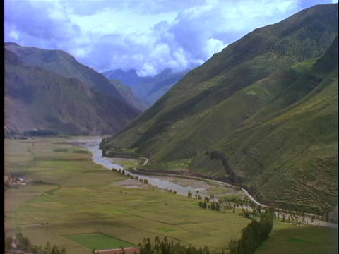 Farmland stretches across a fertile valley in Peru Stock Video Footage