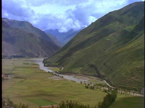 Farmland stretches across a fertile valley in Peru Footage