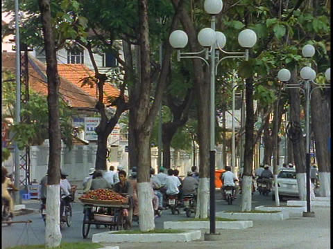 Traffic drives down a busy street in Ho Chi Minh City,... Stock Video Footage