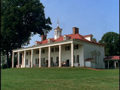 Tourists walk around Mount Vernon, the former home of president George Washington Footage