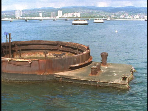 The top of a large rusty tank sits open above the oceans... Stock Video Footage