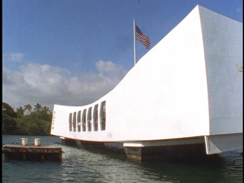 An American flag waves over the USS Arizona Memorial Footage