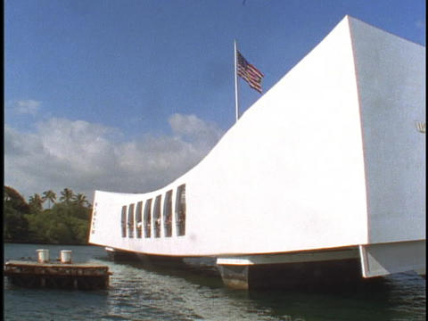 An American flag waves over the USS Arizona Memorial Stock Video Footage