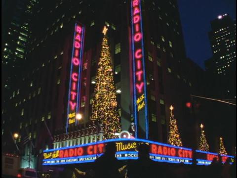 Christmas trees twinkle above Radio City Music Hall Stock Video Footage