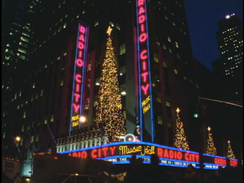 Christmas trees twinkle above Radio City Music Hall Footage