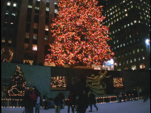 Ice skaters circle Rockefeller Center Stock Video Footage