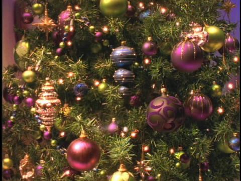 Glass ornaments of purple, maroon and blue decorate the... Stock Video Footage