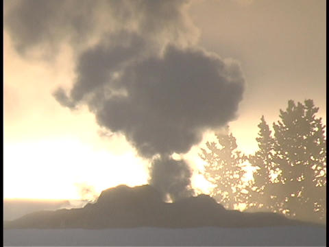 Smoke spews from a geothermal feature in Yellowstone... Stock Video Footage