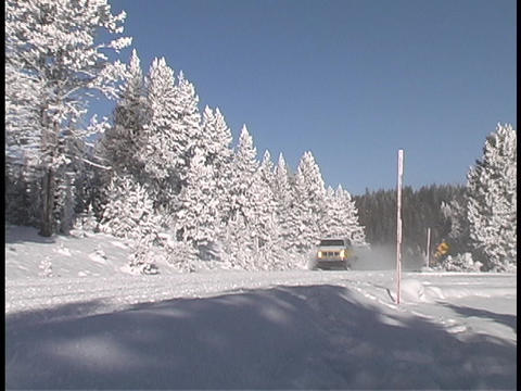 A van drives down a snow covered road Stock Video Footage