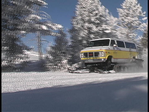 A van drives down a snow covered road Footage