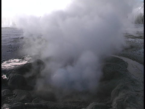 A geyser releases steam in Yellowstone National Park Footage