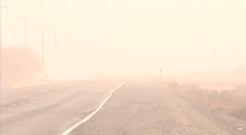 A dust storm obscures a road through the desert Stock Video Footage