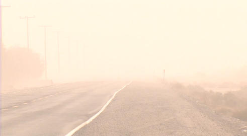 A dust storm obscures a road through the desert Live Action