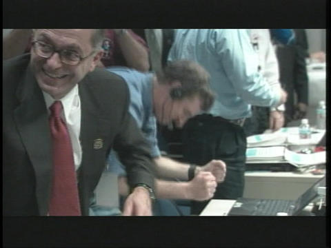 Scientists celebrate in the control room at NASA Stock Video Footage