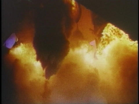 Flames erupt from beneath a rocket Footage
