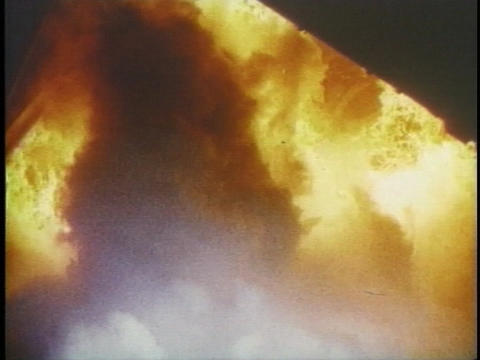 Flames erupt from beneath a rocket Stock Video Footage
