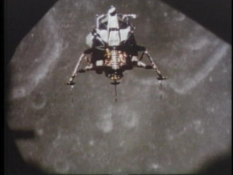 The NASA moon lander floats over the moon Stock Video Footage