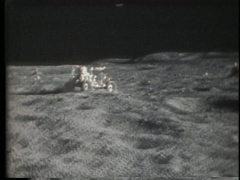 The lunar rover drives over the moon surface Footage