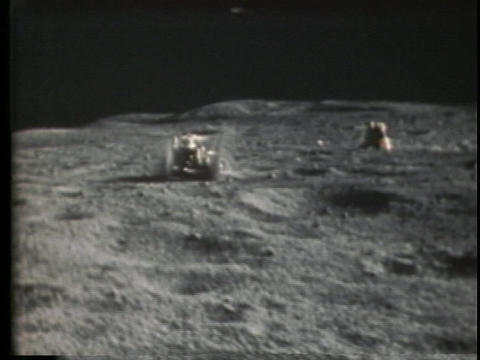 The lunar rover drives over the moon surface Stock Video Footage