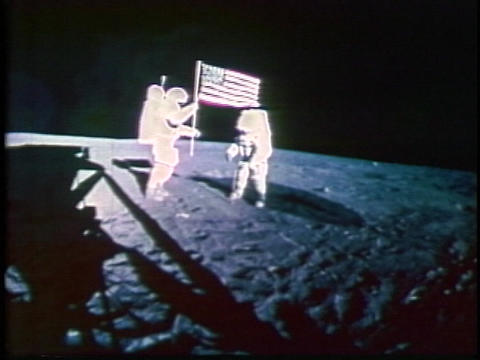 American astronauts plant a flag on the moon Stock Video Footage