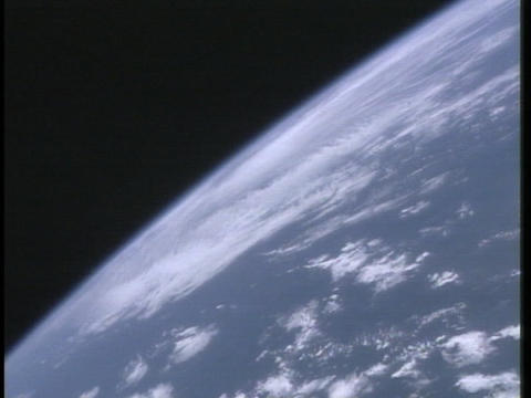 Clouds drift through the Earth's atmosphere Stock Video Footage