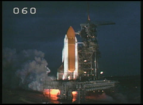 Medium of space Shuttle lifting off from its launch pad at night Footage