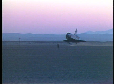 Space Shuttle coming in for a landing in golden-hour light Stock Video Footage