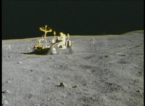 Hand-held shot of astronauts driving a lunar vehicle on... Stock Video Footage