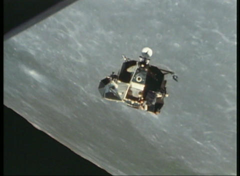 Aerial shot of the Apollo lunar module circling the moon Stock Video Footage
