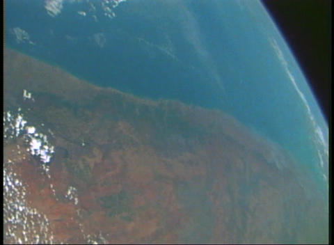 Aerial view from an orbiting spacecraft looking back at earth Footage