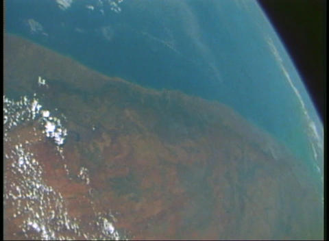 Aerial view from an orbiting spacecraft looking back at... Stock Video Footage