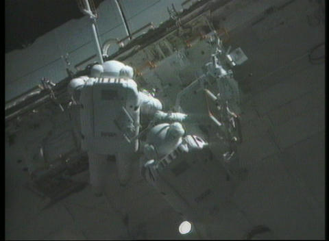 Medium shot of astronauts fixing panels on the... Stock Video Footage