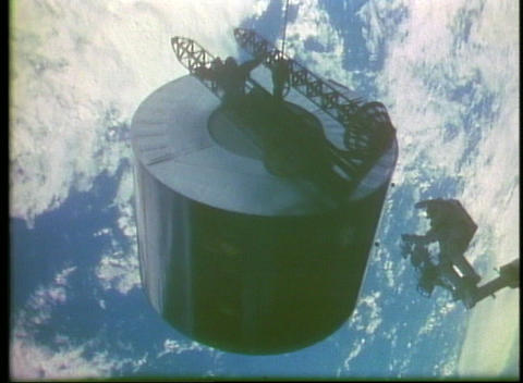 Hand-held view of an astronaut spinning a satellite to... Stock Video Footage