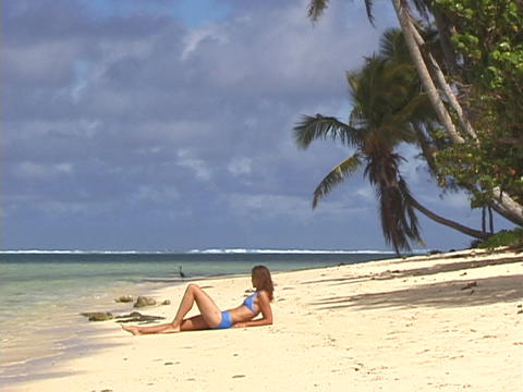 A woman lies on the beach Stock Video Footage