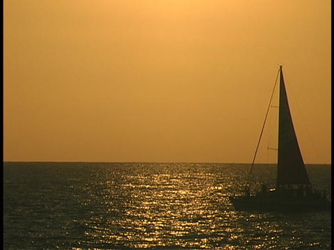 A sailboat sails across the ocean Stock Video Footage