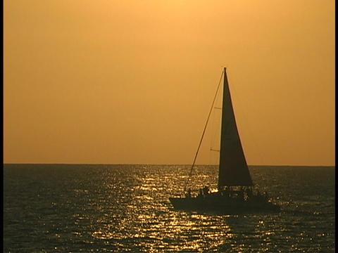 A sailboat sails across the ocean Footage
