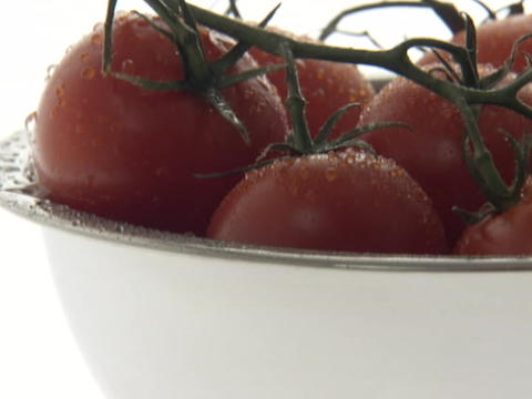 Water droplets drip down cherry tomatoes in a bowl Stock Video Footage