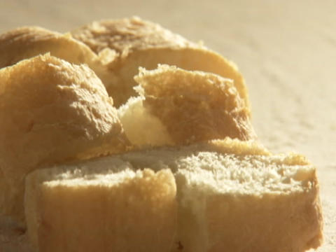 Cut bread sits on a countertop Stock Video Footage
