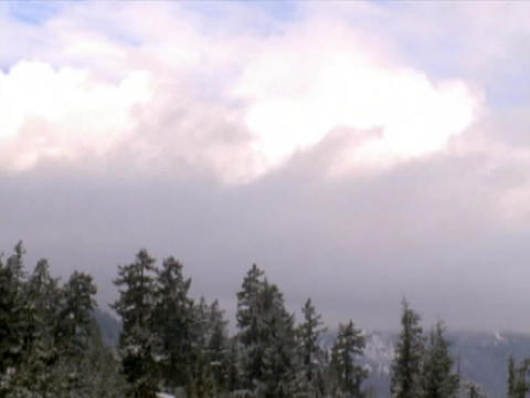Clouds drift over the Sierra Nevada mountains Stock Video Footage