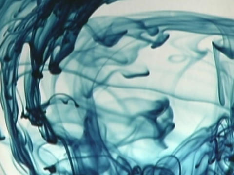 Liquid dye drops into a clear liquid Stock Video Footage