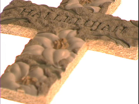 The word Hallelujah and lilies decorate a Christian cross Footage
