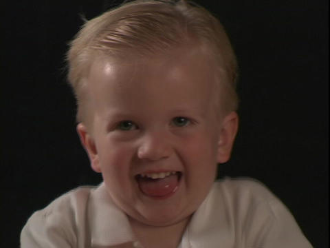 A little boy smiles and laughs Stock Video Footage