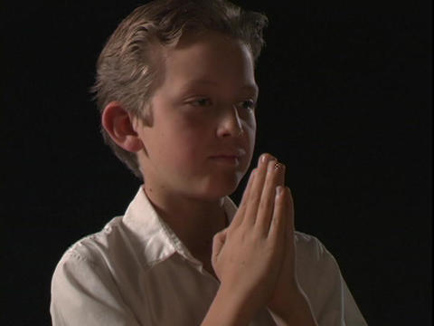 A young boy prays Live Action