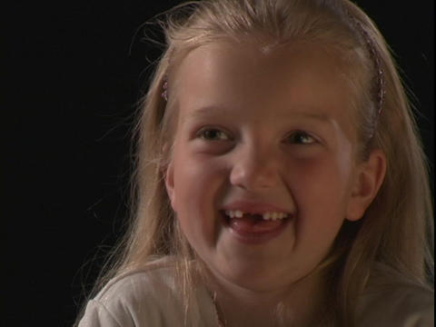 A young girl smiles and makes silly faces Stock Video Footage