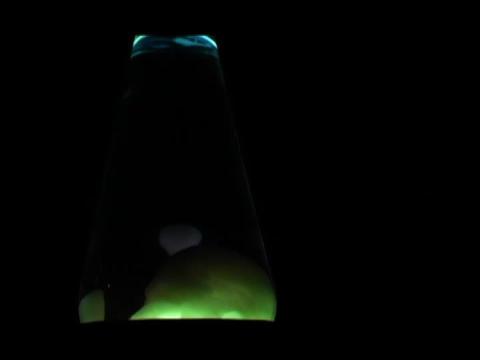 Blobs float in a lava lamp Stock Video Footage