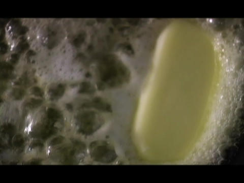 Melted butter forms into a stick Footage