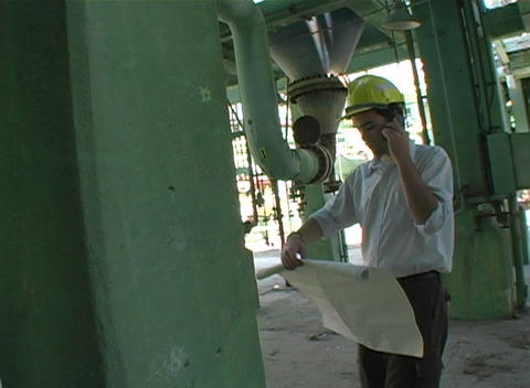 Tracking shot of a contractor holding up a blueprint Stock Video Footage