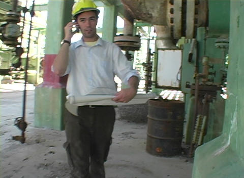 Following shot of a contractor speaking on his cell phone Stock Video Footage