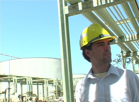 Following shot of a contractor walking around an... Stock Video Footage